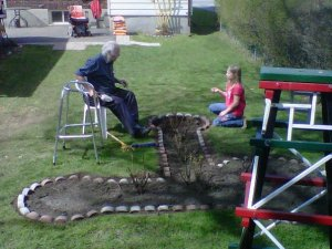 My daughter helping our 86 year old neighbour