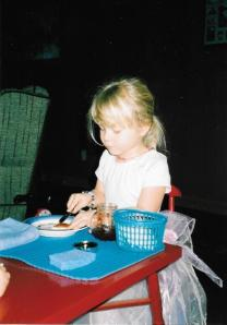 My daughter when she was 4 years old. Preparing her own snack the Montessori way!